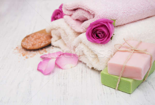 Stock photo: Bath towels and soap with pink roses
