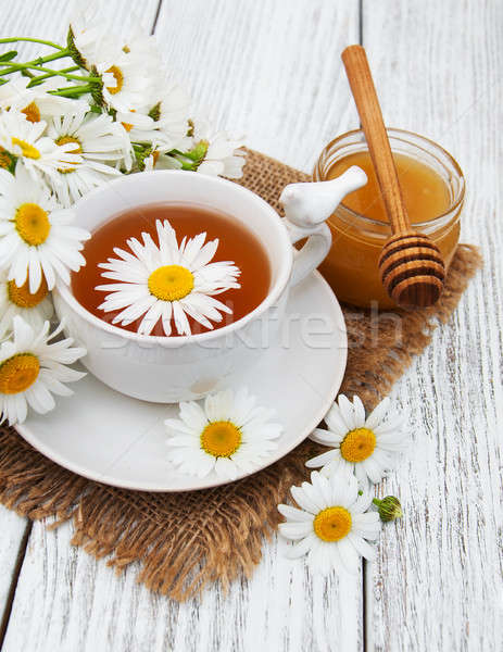 cup of herbal tea with chamomile flowers Stock photo © almaje