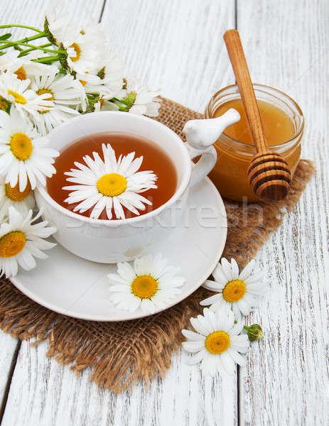 Fincan bitkisel çaylar çiçekler ahşap masa çiçek Stok fotoğraf © almaje