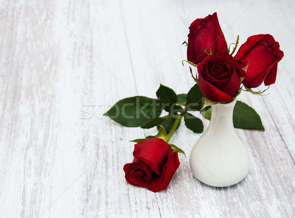 Vase roses rouges vieux bois fleur texture Photo stock © almaje
