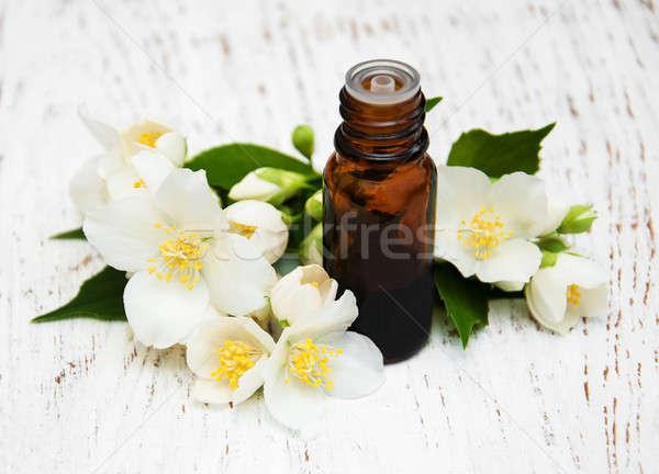 Aceite de masaje flores belleza masaje relajarse Foto stock © almaje