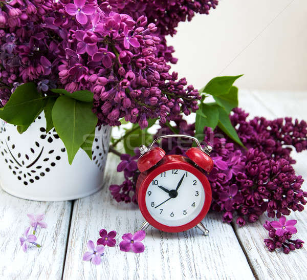 Lilac flowers with alarm clock Stock photo © almaje