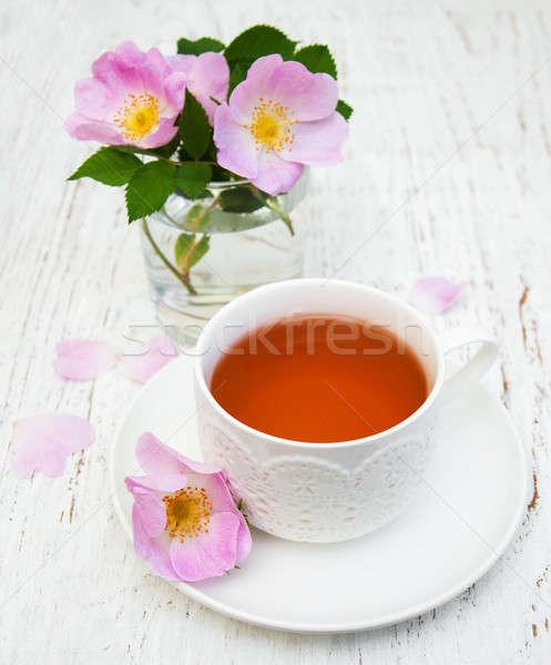Cup of tea and dogrose Stock photo © almaje