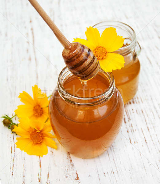 Honey and cosmos  flowers  Stock photo © almaje
