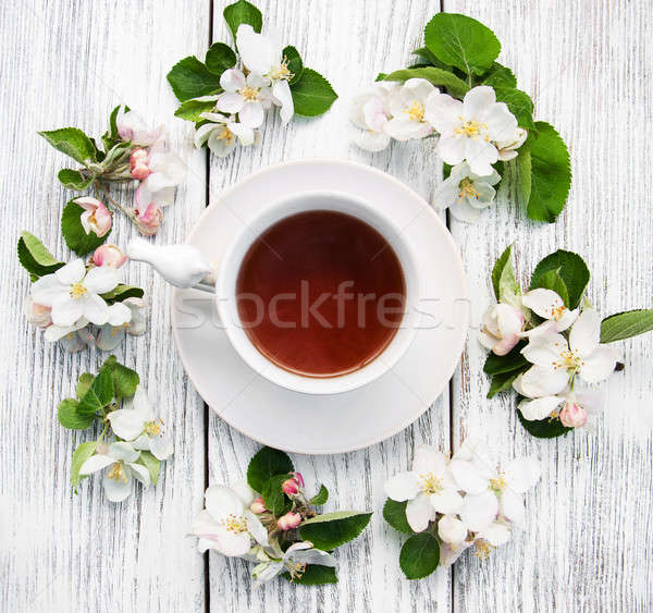 cup of tea with apple blossoms Stock photo © almaje
