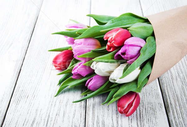 Virágcsokor tulipánok öreg fa asztal tavasz természet Stock fotó © almaje