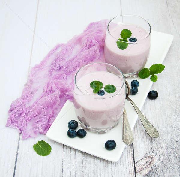 Szemüveg áfonya joghurt asztal friss bogyók Stock fotó © almaje