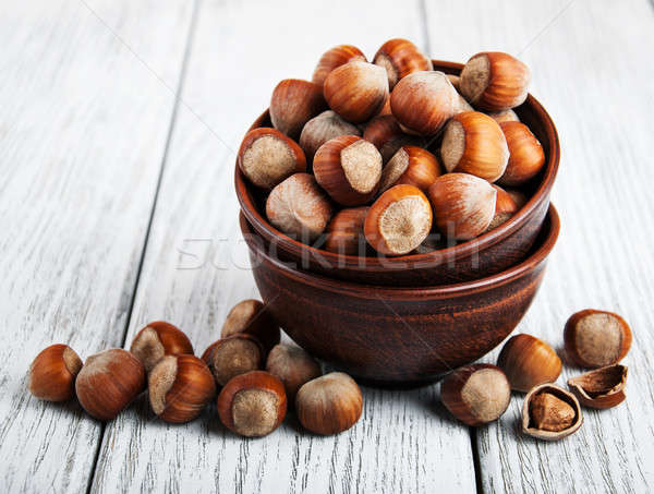 Kom hazelnoten oude houten tafel gezondheid groep Stockfoto © almaje