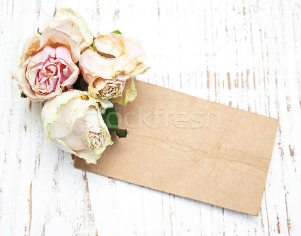 old paper with dried roses Stock photo © almaje