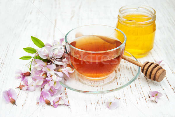 Cup of tea and acacia flowers Stock photo © almaje