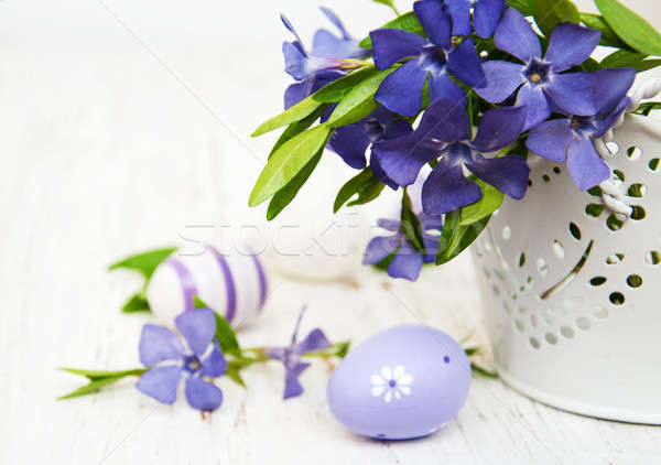 bucket with  periwinkle and easter eggs Stock photo © almaje