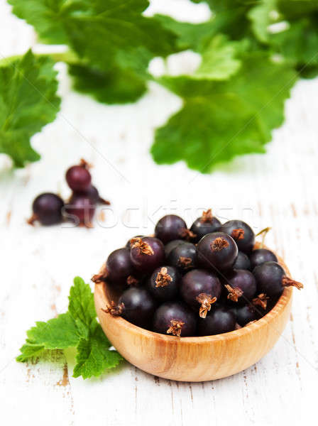 Bowl with black currant Stock photo © almaje