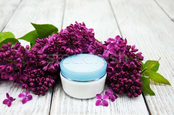 moisturizing cream and lilac flowers Stock photo © almaje