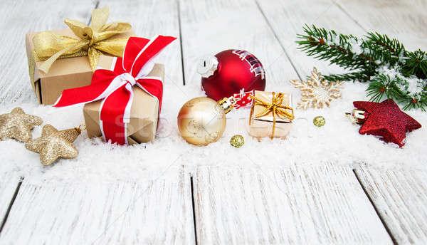 Karácsony díszítések hó golyók fenyő ág Stock fotó © almaje