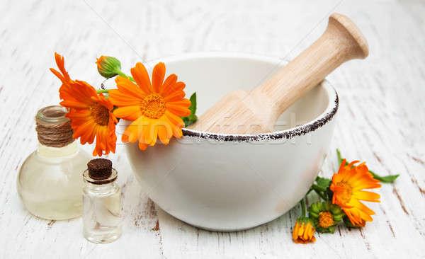 calendula flowers and massage oil Stock photo © almaje