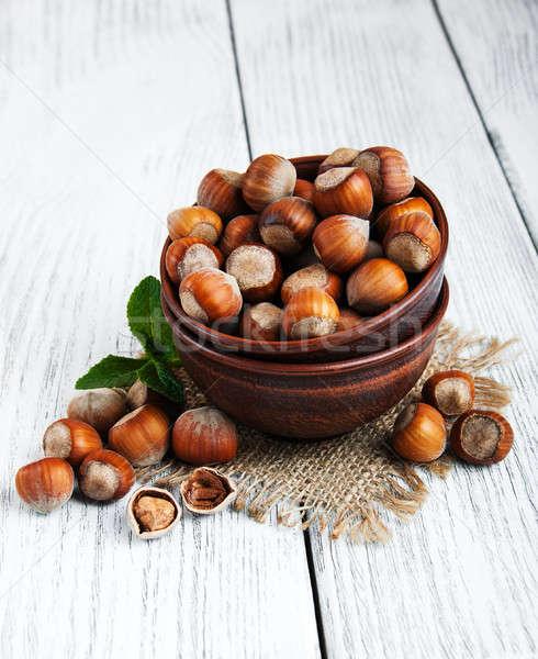 Tál mogyoró öreg fa asztal egészség zöld Stock fotó © almaje