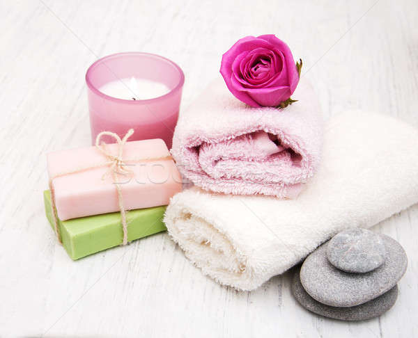 Stock photo: Bath towels, candle and soap with pink roses