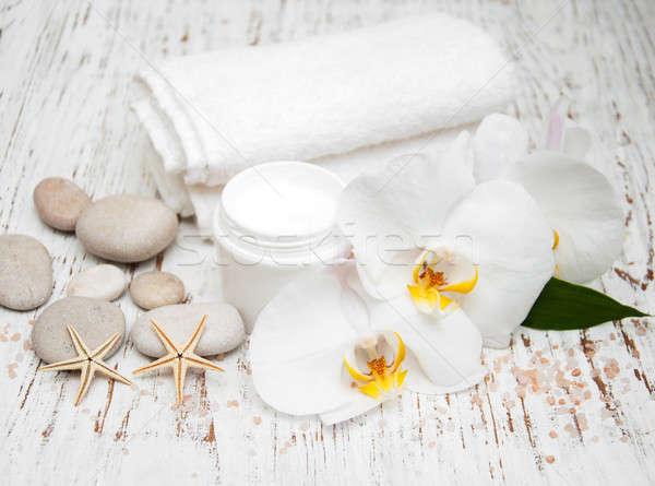 spa essentials cream white towels and orchids Stock photo © almaje