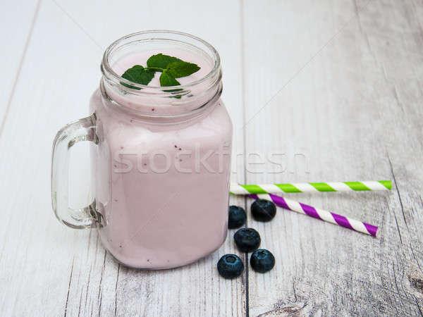 Glass with blueberry yogurt Stock photo © almaje