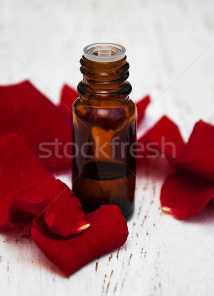 Essential oil and rose petals Stock photo © almaje