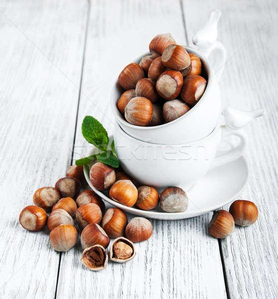 Cups with hazelnuts Stock photo © almaje