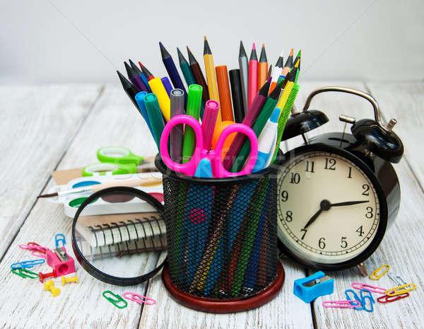 Iskola irodaszerek fa asztal könyv óra alma Stock fotó © almaje