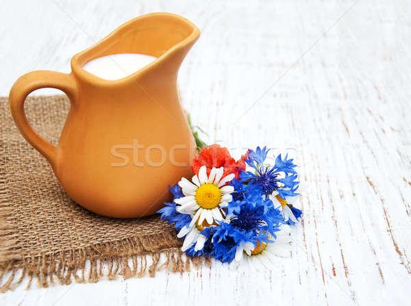 кувшин молоко Полевые цветы старые продовольствие Сток-фото © almaje