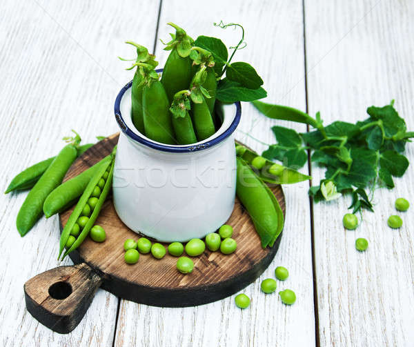 Groene erwten tabel rustiek witte houten Stockfoto © almaje