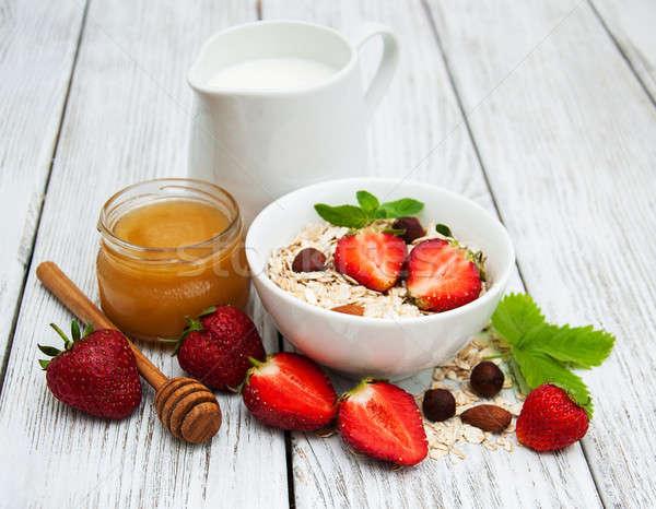 Müzli eprek tej méz öreg fa asztal Stock fotó © almaje