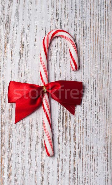 Noël bonbons canne ruban vieux table en bois Photo stock © almaje