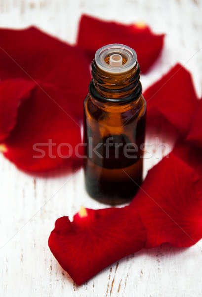 ose flower petals with aromatherapy essential oil  Stock photo © almaje
