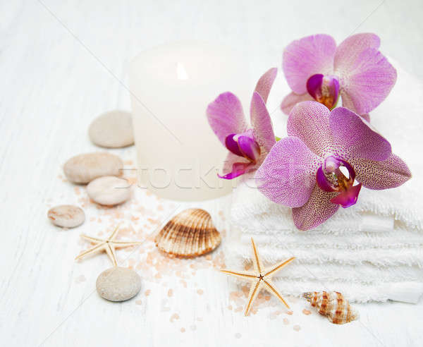 Candle, orcids and towels Stock photo © almaje