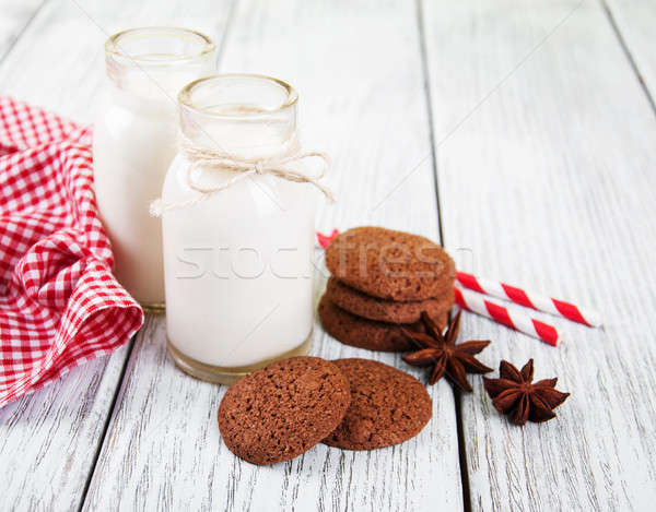 oatmeal cookies and bottles of milk Stock photo © almaje