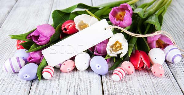 Tulipán virágcsokor üdvözlet húsvét kártya tojások Stock fotó © almaje