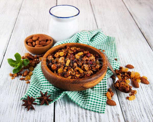 домашний гранола орехи молоко деревянный стол фрукты Сток-фото © almaje