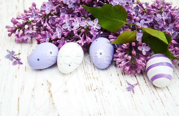 easter eggs and fresh lilac flowers Stock photo © almaje