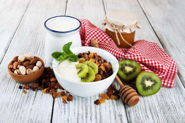 Granola gabonapehely diók joghurt öreg fa asztal Stock fotó © almaje
