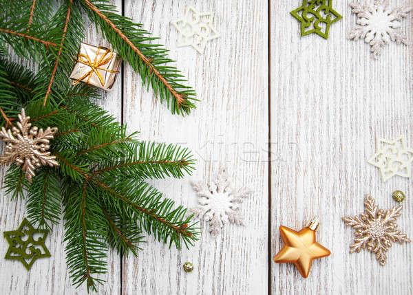 Karácsony fenyőfa dekoráció fa deszka asztal tél Stock fotó © almaje