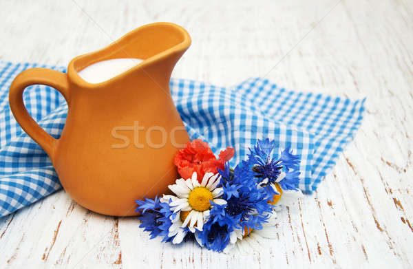 Stock photo: Jug of milk and wildflowers