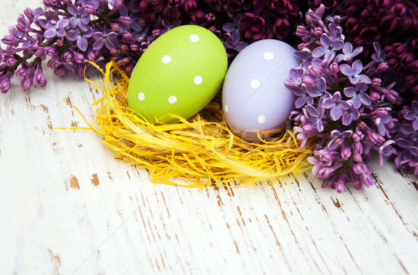 Stock photo: easter eggs and fresh lilac flowers