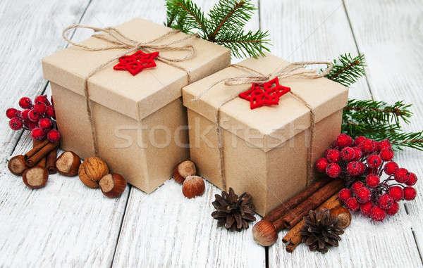 Karácsony ajándékdobozok ajándék doboz mogyoró golyók öreg Stock fotó © almaje