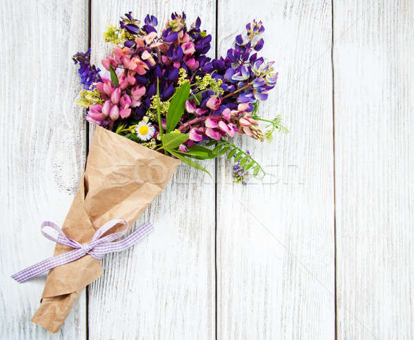 Lupine flowers on a  table Stock photo © almaje