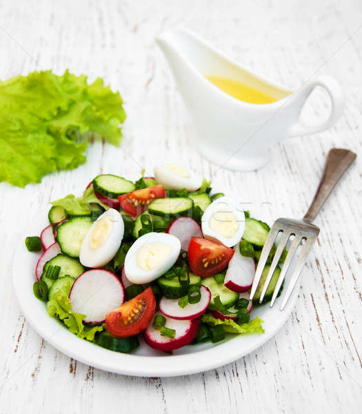 Spring salad with eggs, cucumbers and radish Stock photo © almaje