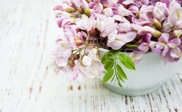 Bowl with acacia flowers Stock photo © almaje
