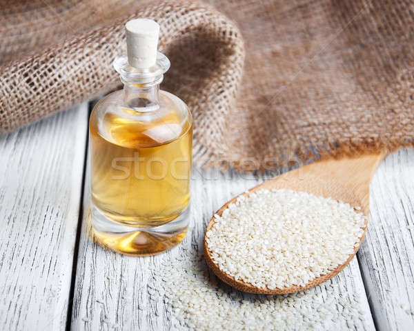 Sesame seeds and bottle with oil Stock photo © almaje
