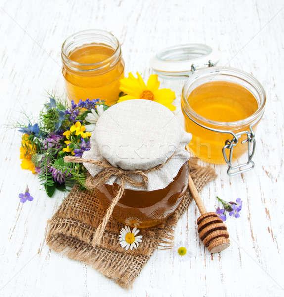 Honey and wild flowers Stock photo © almaje