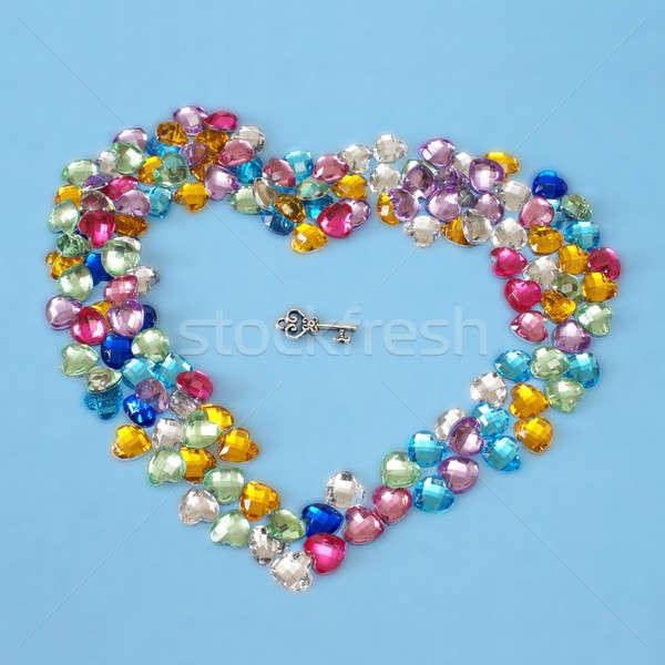 Kluczowych serca wewnątrz wiele kształt serca znaczenie Zdjęcia stock © AlphaBaby