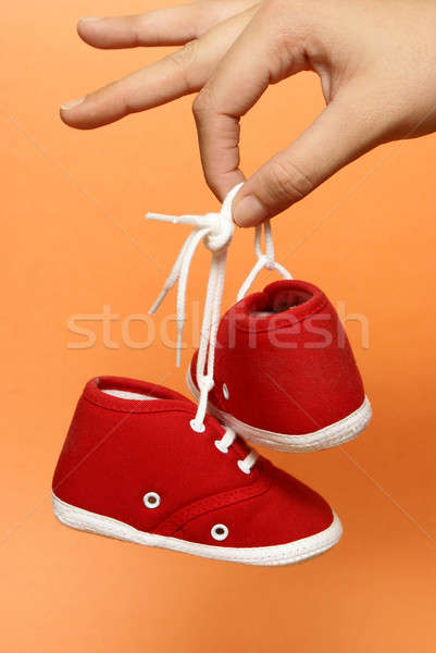 Holding Baby Shoes Stock photo © AlphaBaby