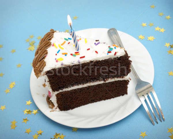 Gâteau bougie tranche gâteau au chocolat anniversaire fourche Photo stock © AlphaBaby