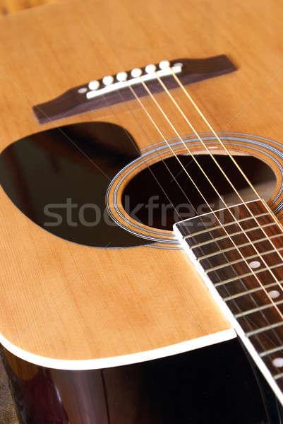 Guitarra acústica primer plano tiro cuerpo de audio cadena Foto stock © AlphaBaby